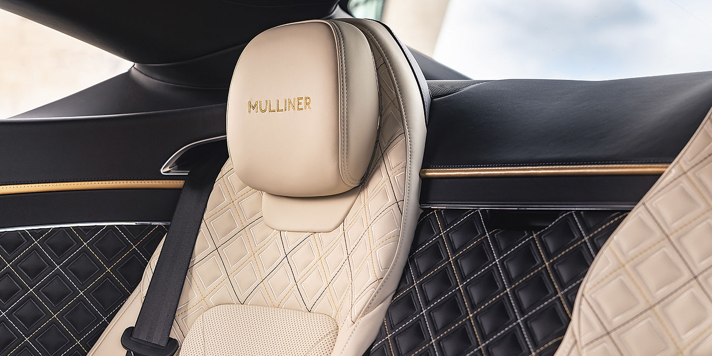 Bentley-Continental-GT-V8-Mulliner-rear-interior-with-Mulliner-seat-quilting-in-Beluga-black-and-Linen-leather-with-gold-accents